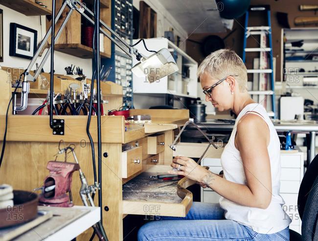 Woman working in a jewelry-making studio