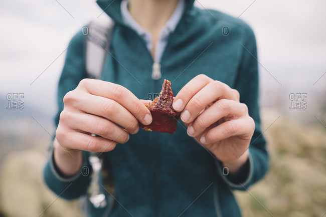 Person holding dried fruit - Offset