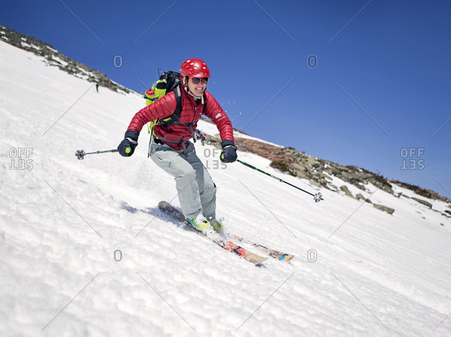 A woman skis down the snowfields near the summit of Mount Washington, New Hampshire
