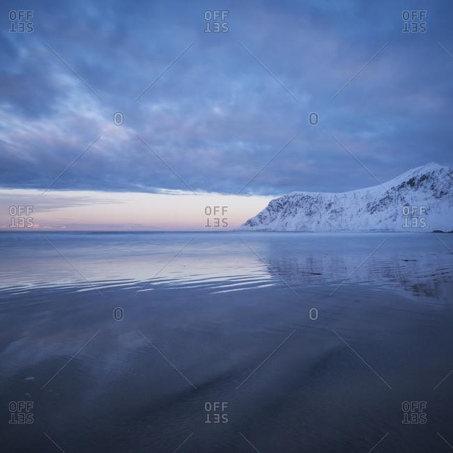 Soft winter light reflecting on Skagsanden beach, Flakstadoy, Lofoten Islands, Norway