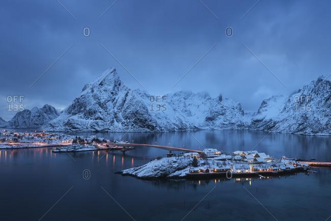 Winter twilight view over rorbu cabins of Sakrisoy, Reine, Moskenesoy, Lofoten Islands, Norway