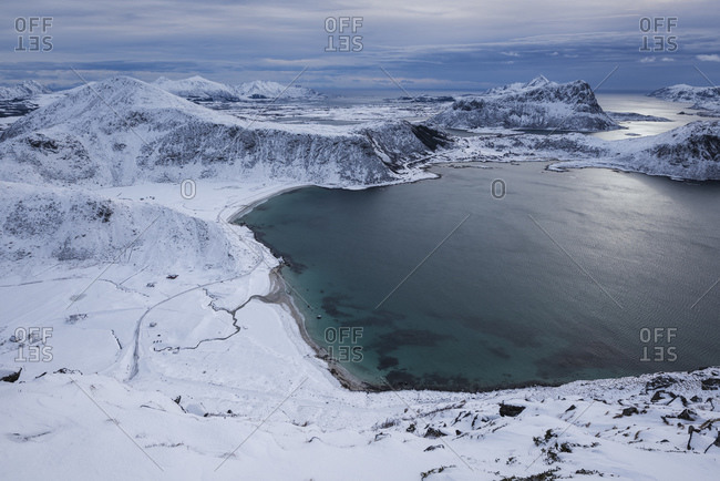 Winter view over snow covered Haukland and Vik beaches from summit of Mannen, Vestvagoy, Lofoten Islands, Norway