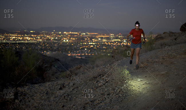 Woman trail running in South Mountain Park, Phoenix, Arizona