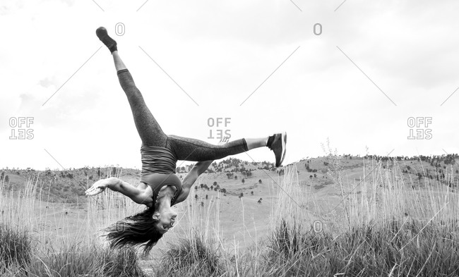 Strong, athletic female does an aerial