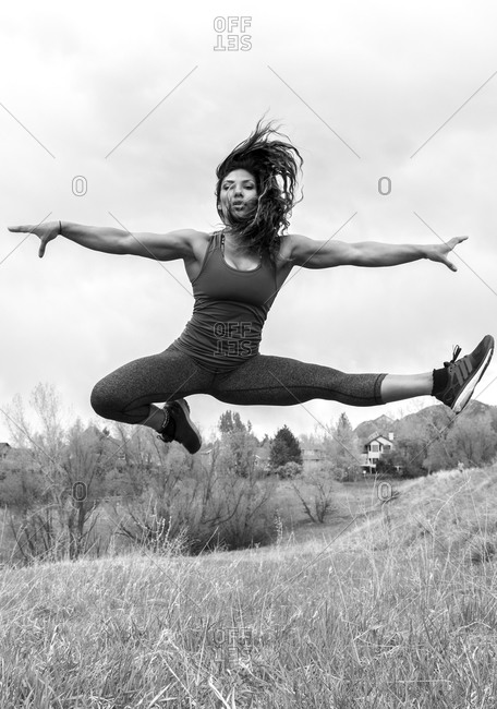 Powerful female athlete jumps into the air