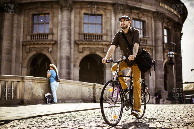 Man riding his bicycle in Berlin, Germany