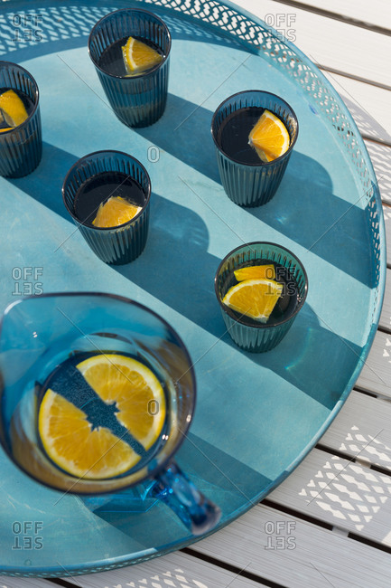 Water glasses with orange slices
