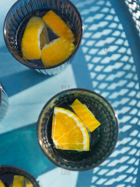 Water glasses with orange slices on platter