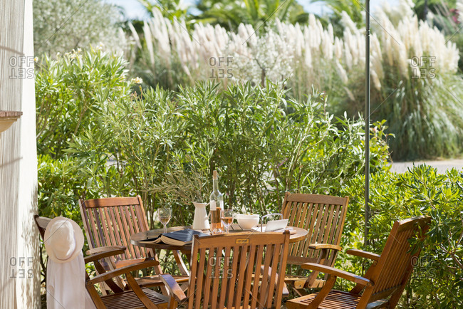 Wooden outdoor patio table set for a meal