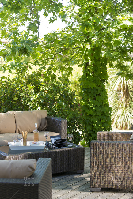 Patio furniture with appetizer set on a coffee table