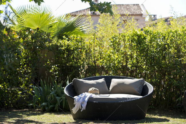 Round outdoor sofa on a grassy lawn