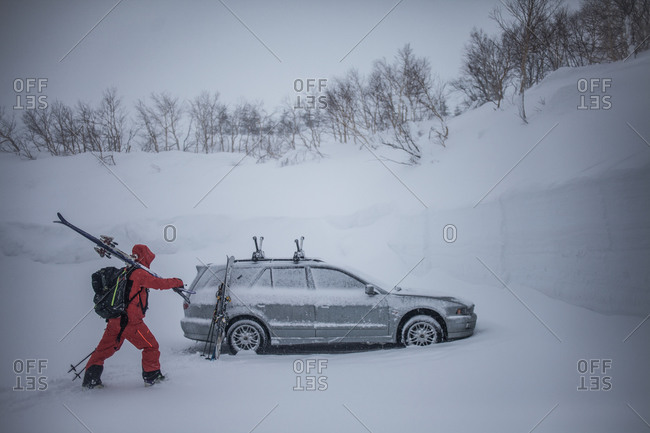 January 26, 2015: A skier approaches his car