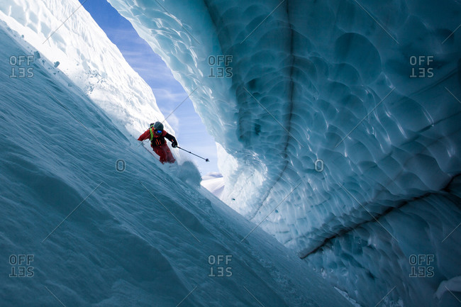 A skier in an ice cave