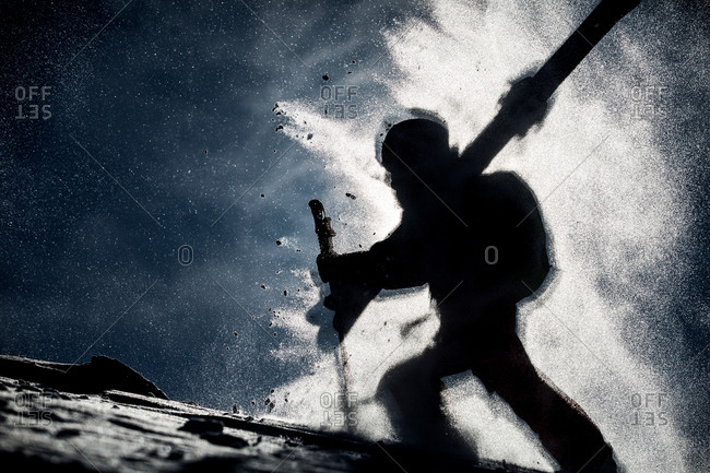 A skier in a cloud of snow