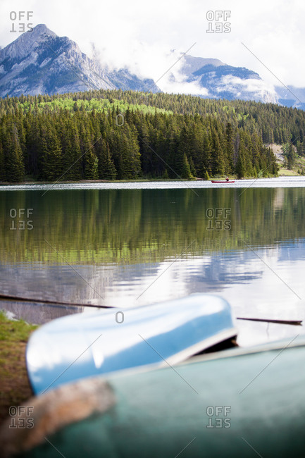 Overturned canoes on the shore of a lake in Banff National Park, Canada
