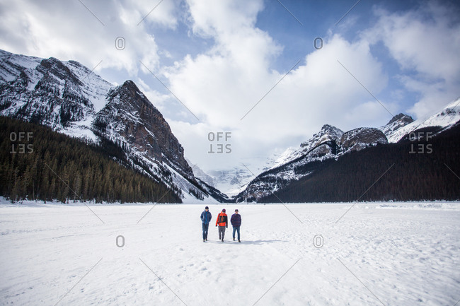 Sept 22, 2015: Three men walking across a snow field in the mountains