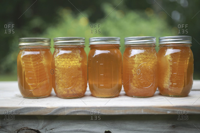 Mason jars of honey and honeycomb
