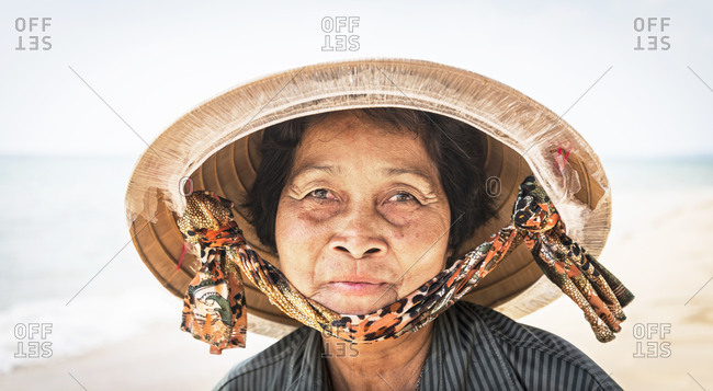 April 16, 2015: A portrait of a fruit seller on Long Beach in Phu Quoc Island, Vietnam