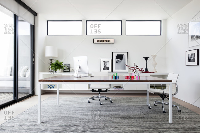 Venice Beach, California - September 3, 2015: Minimal office space in sunny room, interior designed by Timothy Brown