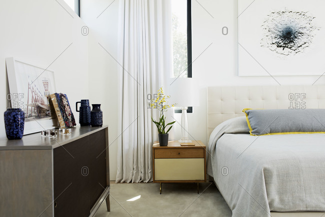 Venice Beach, California - September 3, 2015: Bed and minimalist bedroom furnishings, interior designed by Timothy Brown