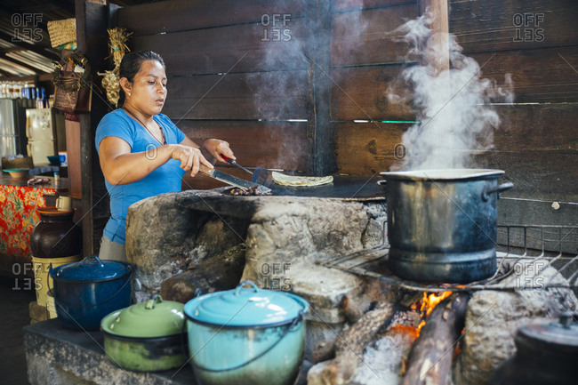 July 29, 2015: Woman cooking street food, Oaxaca, Mexico
