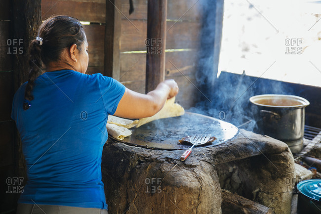 Woman cooking street food in Oaxaca, Mexico