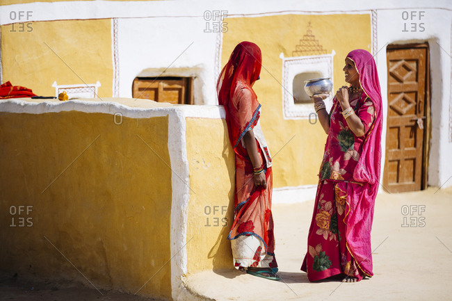 February 4, 2015: Women in saris talking in India