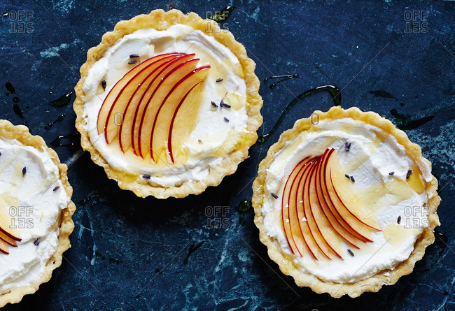 Overhead view of tarts with lavender cr�me and sliced apples