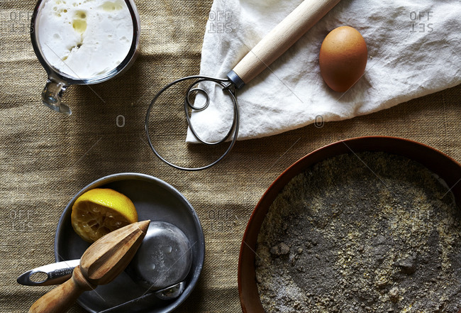 Overhead view of ingredients for baking buckwheat cornbread on burlap background