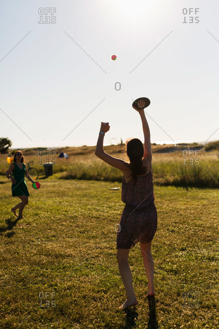 Women play ball with velcro pads
