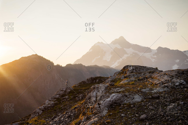 Woman enjoying a mountain view at dawn