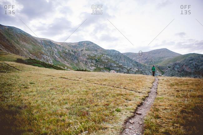 Woman hiking on a mountain path