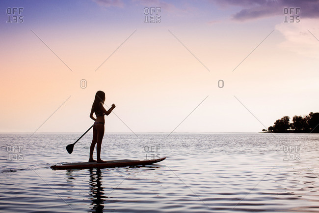 Woman on a stand-up paddleboard