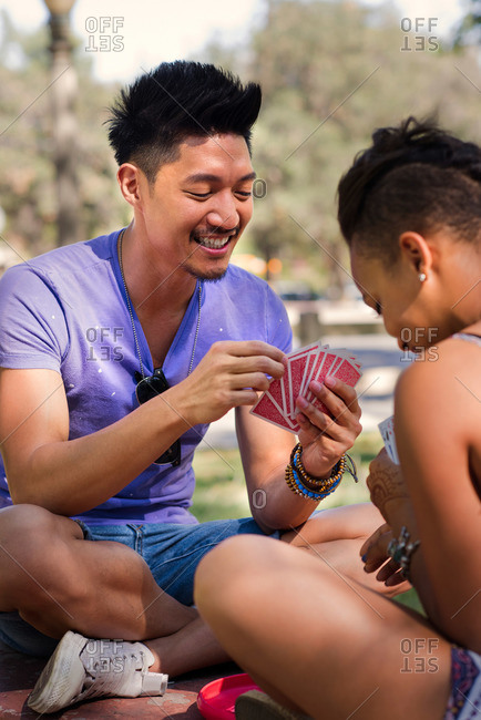 Two friends play cards together