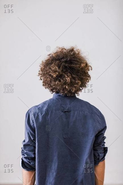 Back View Of Man With Curly Hair Stock Photo Offset