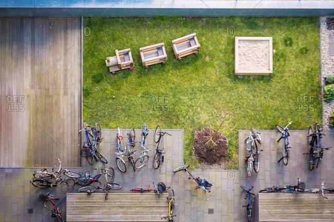 View onto backyard with playground and bikes