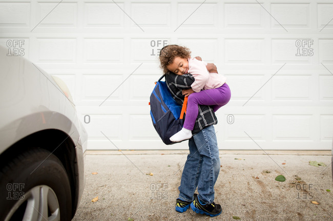 boy picking up a girl