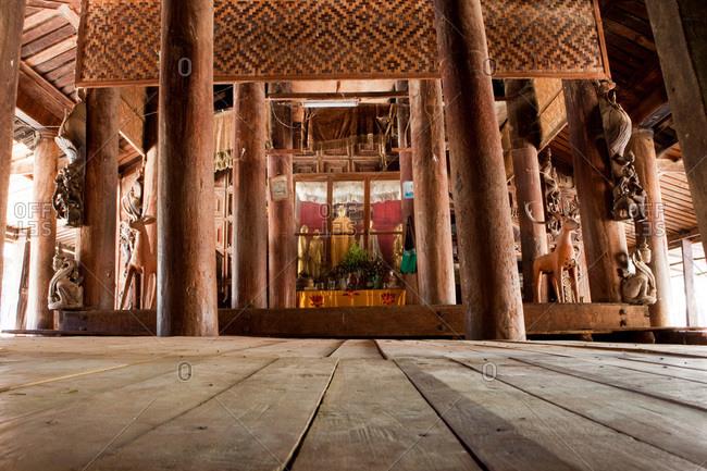 Low angle view inside a Buddhist temple shrine