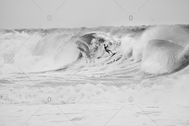 Surfer on large wave in California