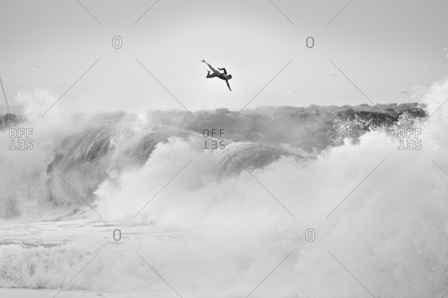 Surfer flying off large wave in California