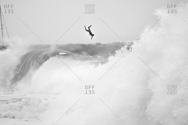 Surfer flying off a large wave in California