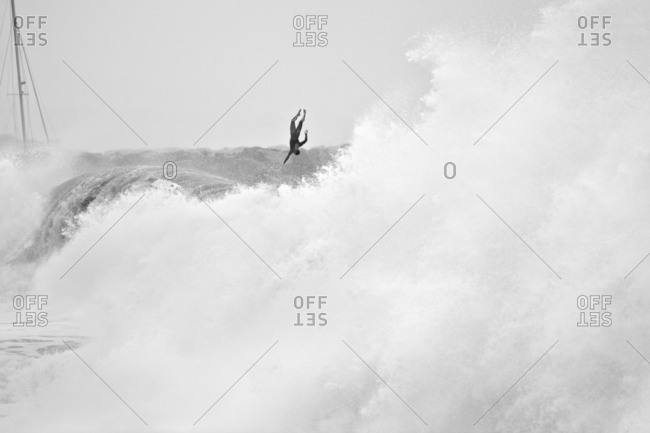 Surfer flying off a large wave, California