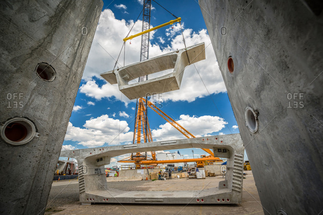 Concrete segments for the new Bayonne Bridge hoisted by a crane in New Jersey