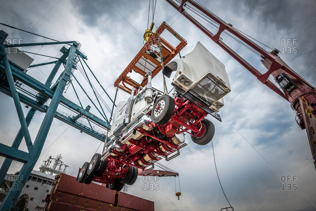 A crane lifts a truck at the Port of Vancouver, Washington, USA
