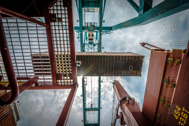 A crane lifting a shipping container at the Port of Vancouver in Washington, USA
