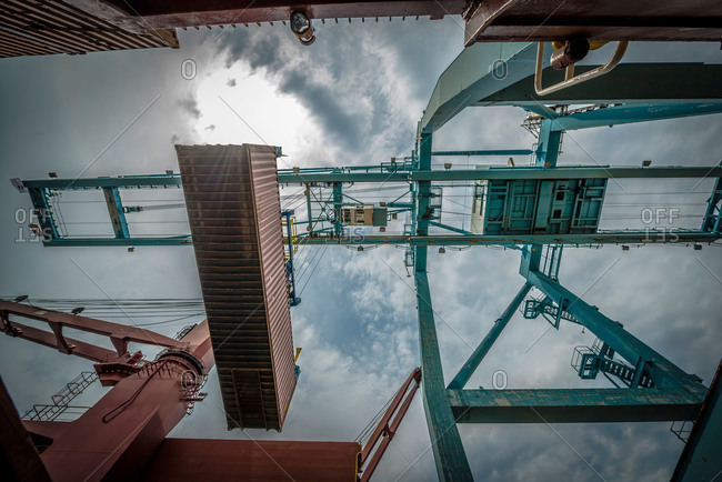 A crane hoisting a shipping container at the Port of Vancouver in Washington, USA