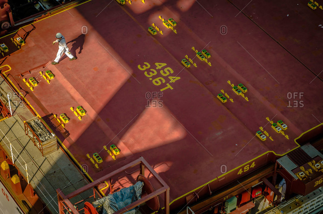 A man walks across a ship at Port of Vancouver in Washington, USA