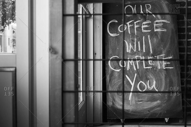 Handwritten witty sign inside a coffee shop