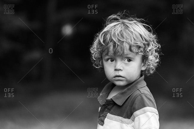 Portrait of a little boy with curly hair