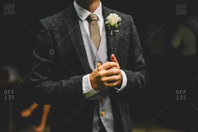 Midsection of man in herringbone wedding coat